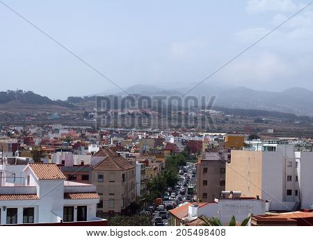 Ariel view of the historic town of San Cristóbal de La Laguna in Tenerife showing the buildings and roads with mountains in the background