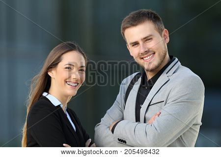 Couple Of Executives Posing On The Street