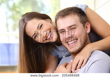 Happy Couple Smiling With Perfect Teeth At Home