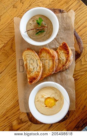 Hummus And Pate With Slices Of Toasted Bread.