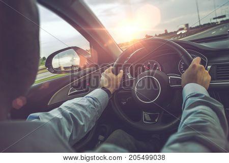 Highway Car Driving. Caucasian Men Behind the Wheel on His Road Trip.