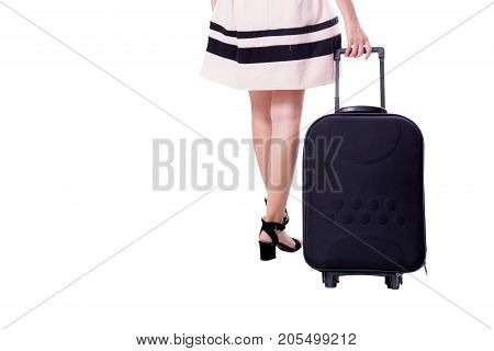 Businesswoman with wheeled travel bag makes step forward back view. Isolated over white background.