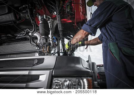Repairing Broken Semi Truck Tractor Engine. Caucasian Trucks Mechanic.