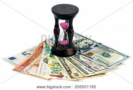 Currency of different countries and hourglass on a white background