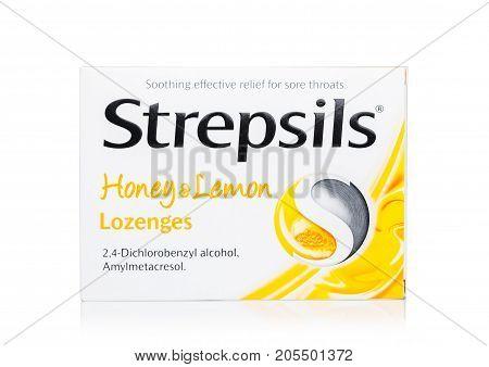 LONDONUK - SEPTEMBER 24 2017: Pack of Lozenges Strepsils Honey & Lemon on white background