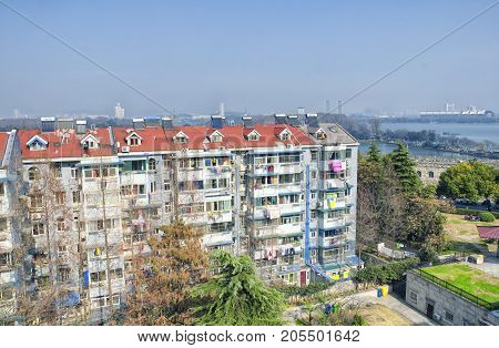 Apartment buildings near the Nanjing city wall and Xuanwu lake and Jiefang Gate in Jiangsu province China in early spring in Jiangsu province China.