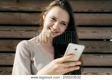 The girl saw something funny in the phone, good news