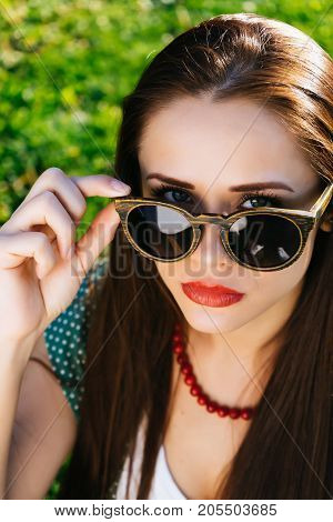 Woman in glasses,girl with sunglasses,copyspace on green