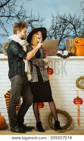 Halloween Girl And Macho Talking And Smiling At Window