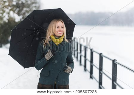 Girl Walking With Umbrella On Winter Day