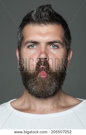 Man With Long Beard On Emotional Grimace Face