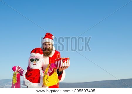 Happy Santa Hipster Holding Present Box On Blue Sky