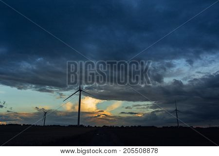 Wind Turbine For Electrical Power Generation In Agricultural Field On A Cloudy Day In Normandy, Fran