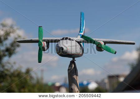wooden plane on a stick. horizontal shot