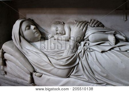 Tomb of mother and child, as understood by photographer, as viewed in Roman church.
