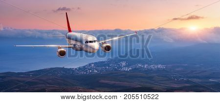 Landscape With White Airplane Is Flying In The Orange Sky