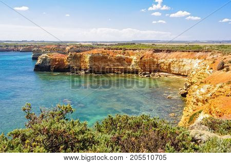 Slowly but surely the blasting winds and waves gradually erode the limestone and form caves in the cliffs - Bay of Martyrs, Victoria, Australia