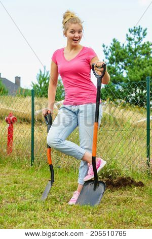 Woman Digging Soil With Shovel