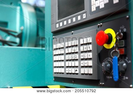Control panel of modern metalworking cnc machine center. Selective focus.
