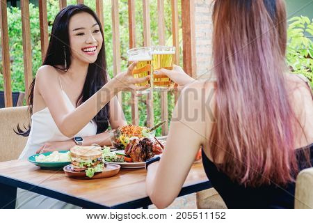 Young Asian Women Drinking Beer And Clink Glasses Happy While Enjoying Home Party