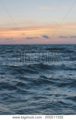 A blank ocean background at sunset .