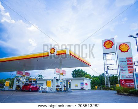 Nakhon Si Thammarat Thailand - July 2 2017: Shell gas station blue sky background. Royal Dutch Shell sold its Australian Shell retail operations to Dutch company Vitol in 2014