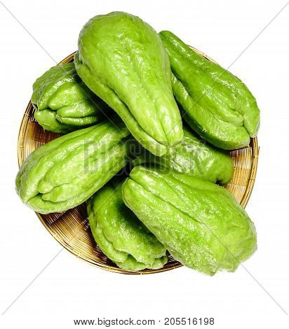 Chayote in basket on white background are healthy food