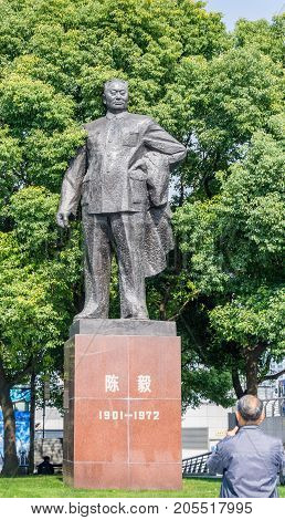 Shanghai, China - Nov 4, 2016: Chen Yi Square at The Bund - People around the statue of Chen Yi (Chinese characters), the first mayor of Shanghai in modern China.
