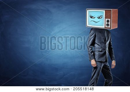A businessman stands half-turned and ready to leave while wearing an old TV with a sceptic emoticon on his head. Doubt and thinking. Bad idea. Unreliable partner.