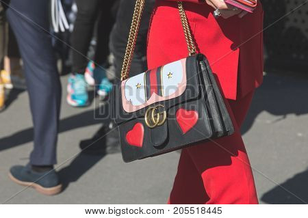 MILAN ITALY - SEPTEMBER 20: Detail of bag outside Gucci fashion show building during Milan Women's Fashion Week on SEPTEMBER 20 2017 in Milan.