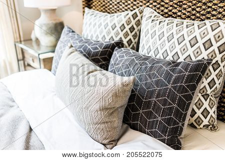 Closeup Of New Bed Comforter With Decorative Pillows, Headboard In Bedroom In Staging Model Home, Ho