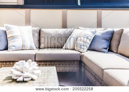 View Of Comfortable Modern Corner Couch With Many Pillows Outside On Loft Balcony With Bright Sun Ra