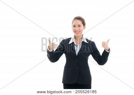 Smiling young Asian businesswoman in black suit and white t-shirt giving 2 thumbs-up ( hand gesture indicating strong approval ) isolated on white background