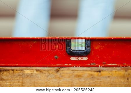 Green bubble level isolated on white background with clipping path at construction site