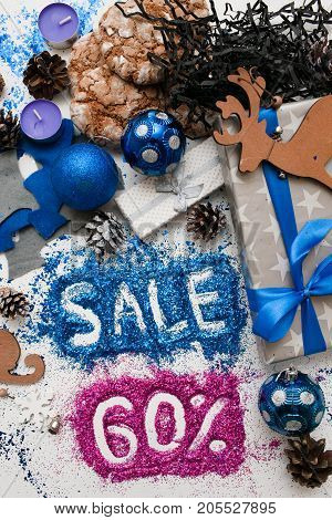 Sales on Christmas and New Year holidays, top view. Festive decoration with informative inscription of 60 pct discount for shop-windows, shopping malls and advertizing background concept