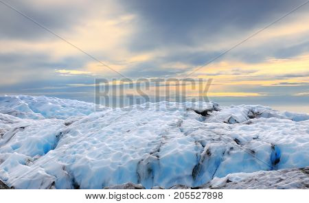 Amazing landscape of the glacier top of Falljokull Glacier (Falling Glacier) in the rays of the setting sun Iceland
