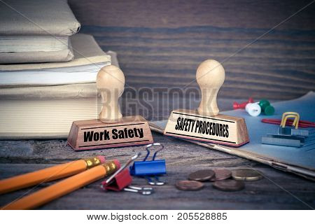 Work Safety and Safety Procedures concept. Rubber Stamp on desk in the Office. Business and work background.