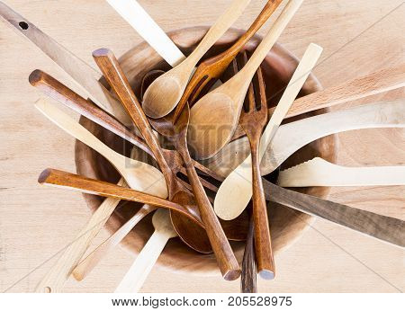 Wooden Bowl With Spoons And Forks On Wooden Background