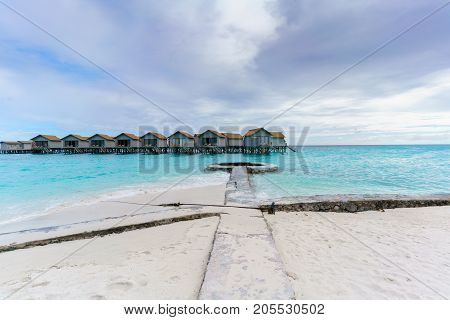 Maldives Island Republic of Maldives - March 2 2017 : Luxury water villas in tropical Maldives island located in the Indian Ocean