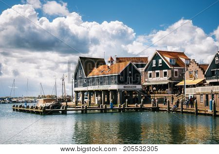 Volendam Netherlands - 26 April 2017: Typical traditional houses on stilts on the waterfront of a Dutch fishing Volendam village Netherlands.