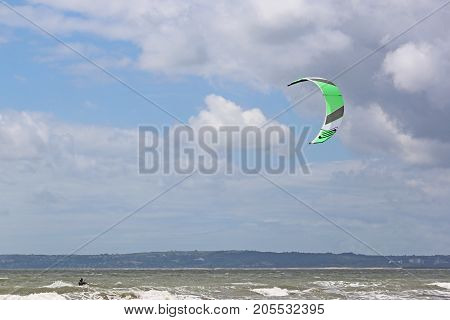 kitesurfer riding in the waves of Swansea Bay