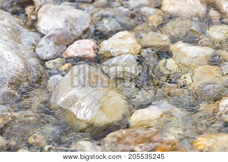 stones in the mountain river . In the park in nature
