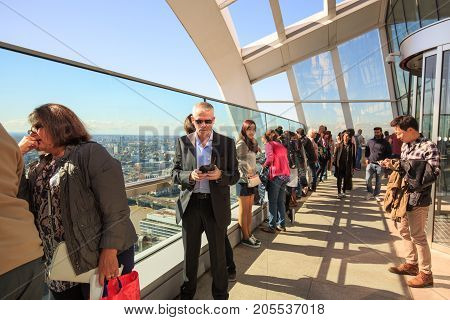 The Sky Garden is situated 35 floors up in the walkie Talkie Building. Tourists enjoying the view from the viewing gallery London 2017