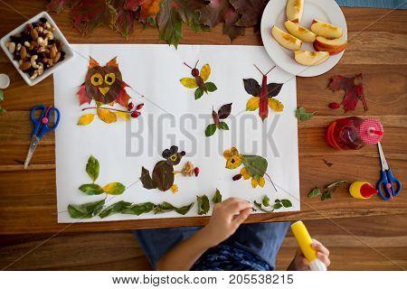 Sweet Child, Boy, Applying Leaves Using Glue