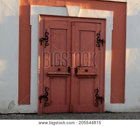 Pink door with ironwork/ The old pink door with ironwork.