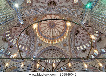 Istanbul, Turkey - April 16, 2017: Decorated ceiling at Sultan Ahmed Mosque (Blue Mosque) showing intersection of the four main domes of the ceiling Istanbul Turkey