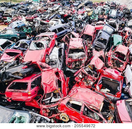 Scrapped Cars Stacked On A Scrap Yard.