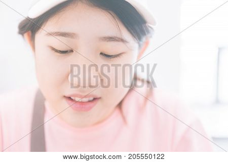 cute young innocent virgin asian teen close up face look shy with space for text