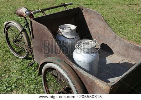 Cart With Old Bicycle To Transport The Milk Just Leavened From T