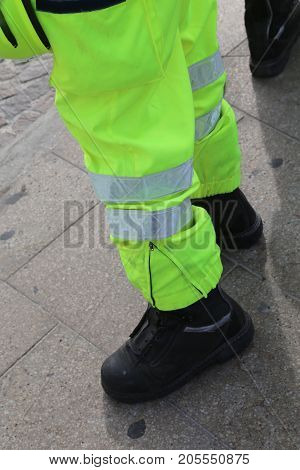 Civil Protection Men With High Visibility Clothing During An Exe